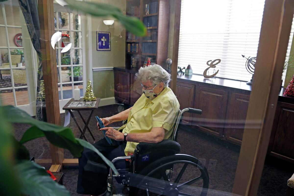 Freddye Riggs, 94, at Elmcroft of Windcrest visits with daughter Laura Riggs via FaceTime. It's been an arduous year for Riggs' mother, Freddye Riggs, and other nursing home residents as facilities were locked down and in-person visits prohibited to prevent the spread of the coronavirus.