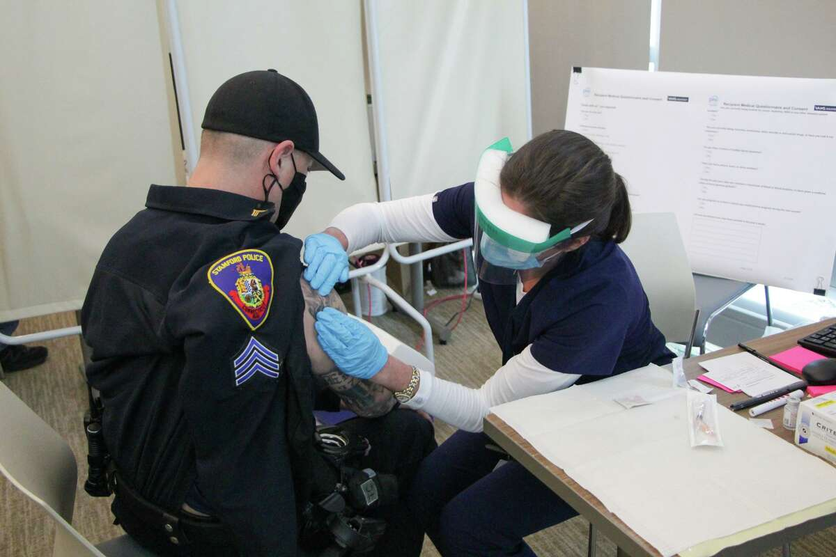 About 280 first responders and medical workers were given a coronavirus vaccine at police headquarters on Thursday.