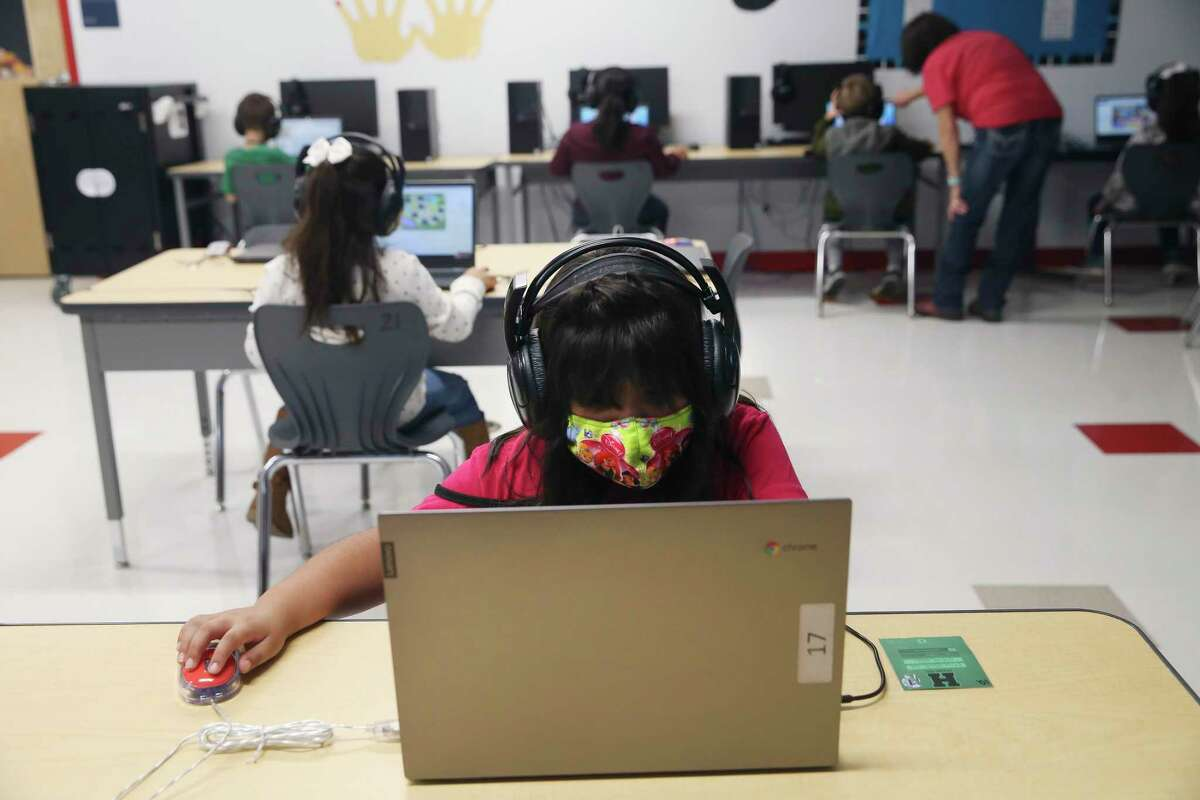 First-grader Marysol Covarrubias works on a lesson during a computer class at Meyer Elementary School in Hondo on the last day of the fall semester, Dec. 18, 2020.