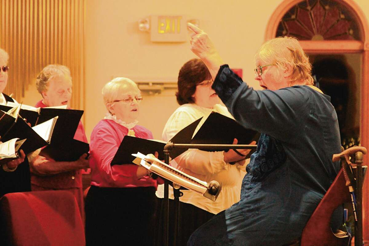 Carol Voigts directs the Manistee Choral Society's Victorian Dessert Concert in 2016.