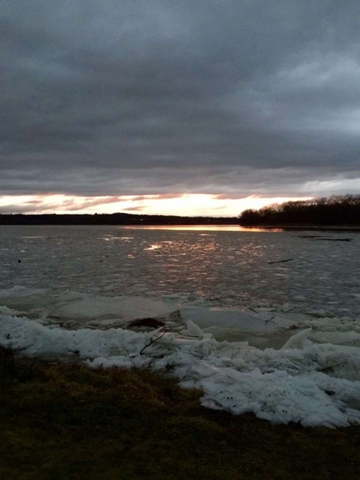 Christmas Day and there as a glow across the Mohawk River's ice in this photo from Mae D'Agostino