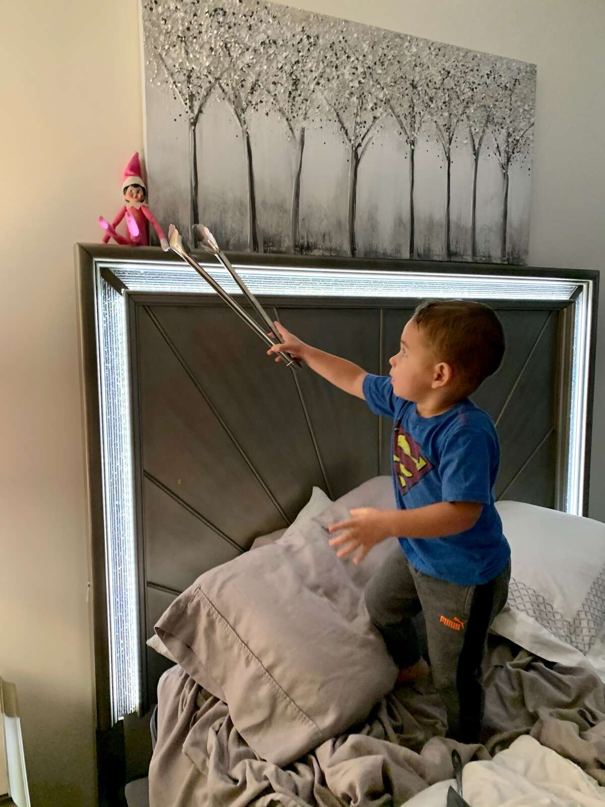 Remember not to touch the elf, or you'll lose the magic.  Two-year-old Landon Harbour of Cohoes found a way to reach out but still preserve the magic.