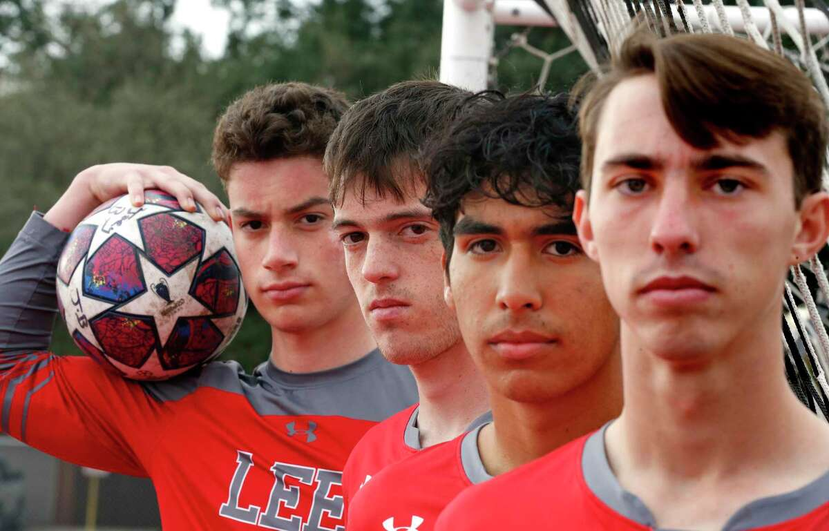 Joey Batrouni,holding ball,Lto R, Henry Bowland,Jonathan Facio, Gavin Seesholtz. Protrait of Lee soccer captains on Tuesday, Dec. 22, 2020.