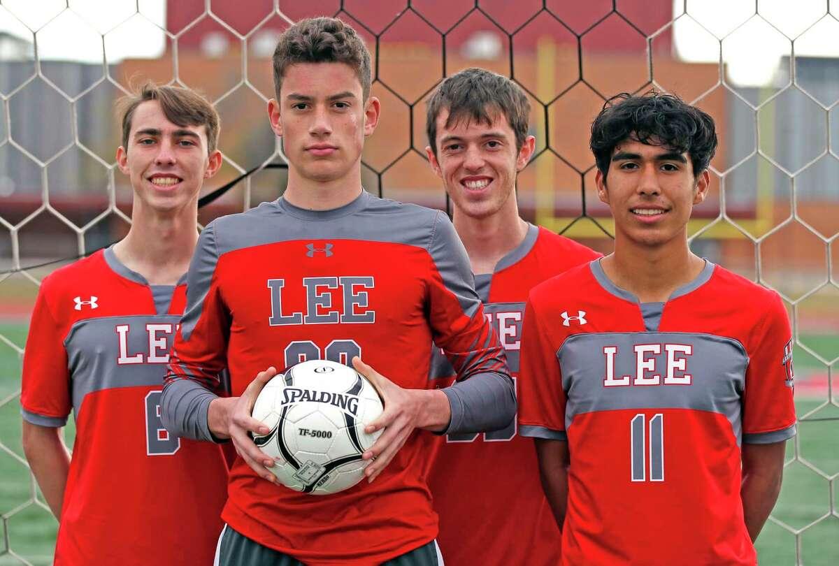 Joey Batrouni,holding ball,Lto R, Gavin Seesholtz,Henry Bowland and Jonathan Facio. Protrait of Lee soccer captains on Tuesday, Dec. 22, 2020.