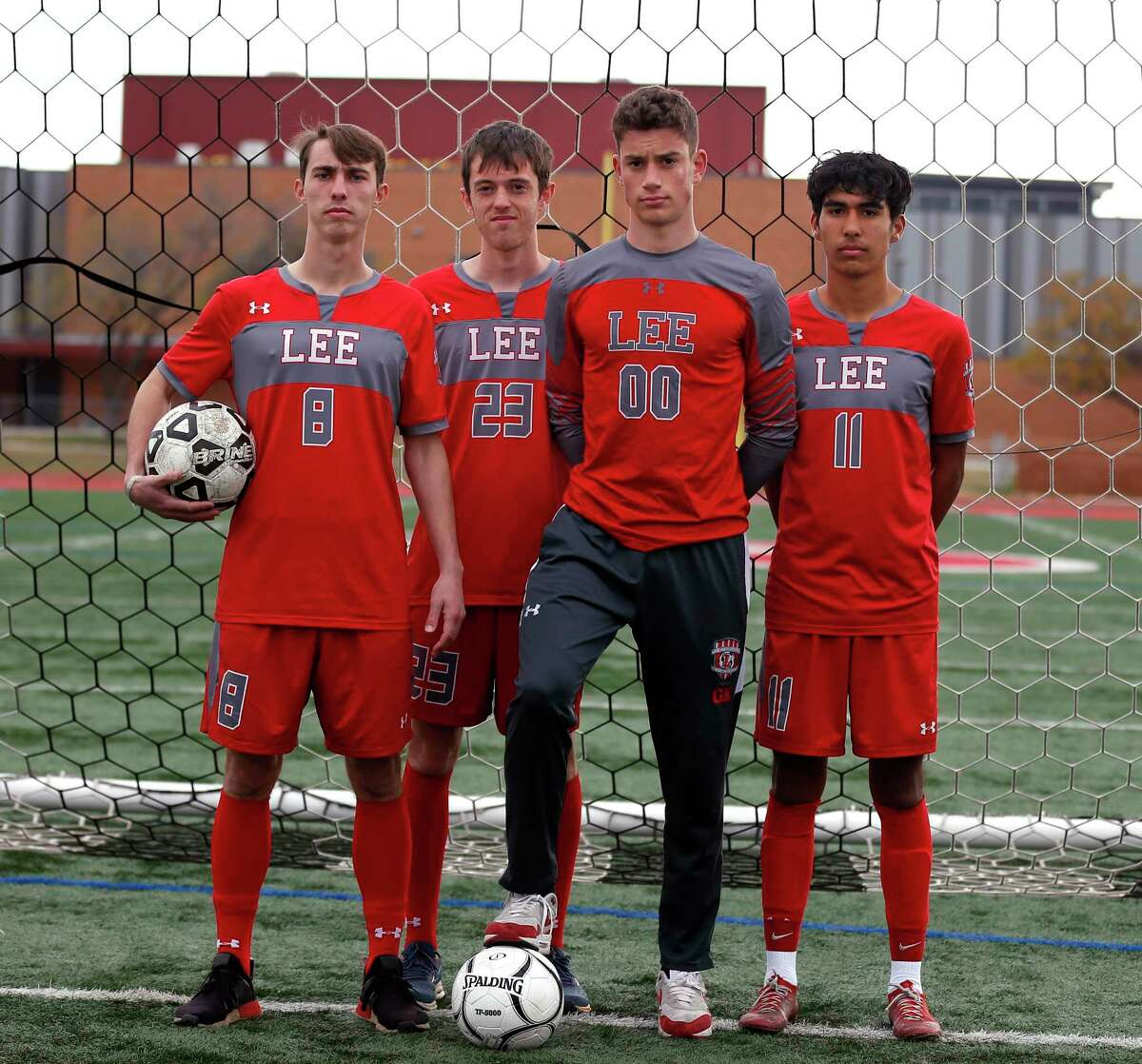 Joey Batrouni,foot on ball,Lto R, Gavin Seesholtz,Henry Bowland and Jonathan Facio. Protrait of Lee soccer captains on Tuesday, Dec. 22, 2020.