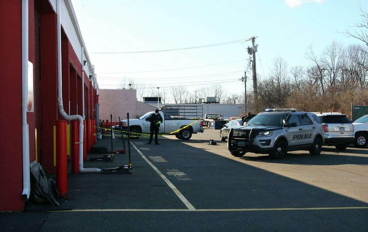 Orange police investigate a fatal shooting at Town Fair Tire in Orange, Conn., on Saturday Dec. 26, 2020.