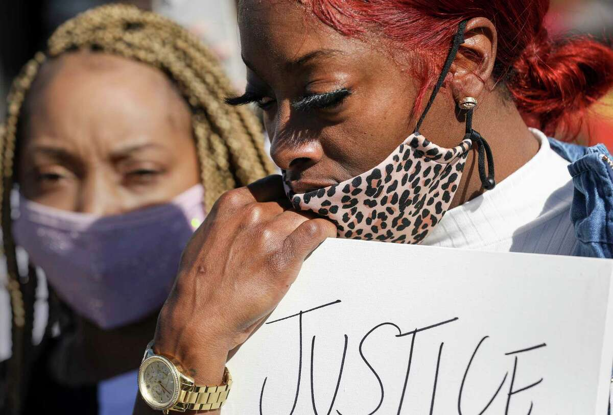 Diamond Reese listens during a protest Saturday, Dec. 26, 2020, at the La Marque Police Department in La Marque. About 150 people gathered to protest the killing of Joshua Feast, who was shot and killed by a La Marque police officer Dec. 9.