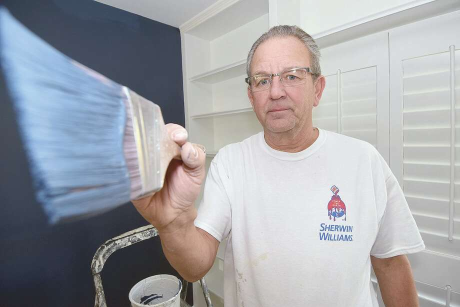 Tim Powell at work painting the interior of a Jacksonville residence. Photo: David Blanchette | Journal-Courier