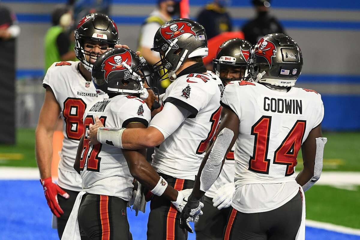 Quarterback Tom Brady (center) celebrates a touchdown with wide receiver Antonio Brown (81) during the second quarter of the Buccaneers' big win over the Lions in Detroit.
