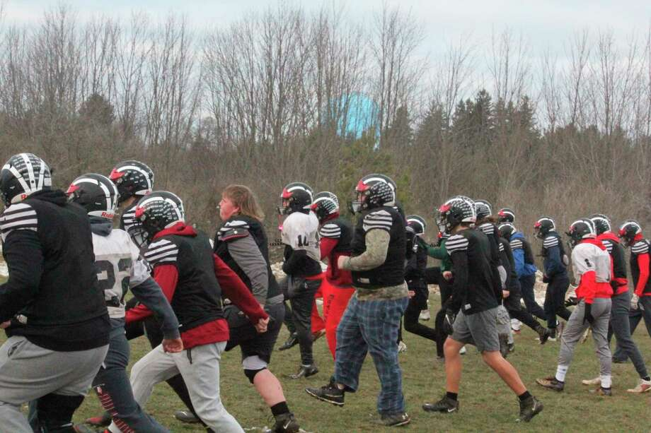 Reed City football players go through a practice drill on Dec. 22. Practices were suspended by the state until rapid testing procedures could be clarified. Practices are to resume on Monday. Reed City is scheduledtohave a home game on Jan. 9 against Freeland. (Pioneer photo/John Raffel)