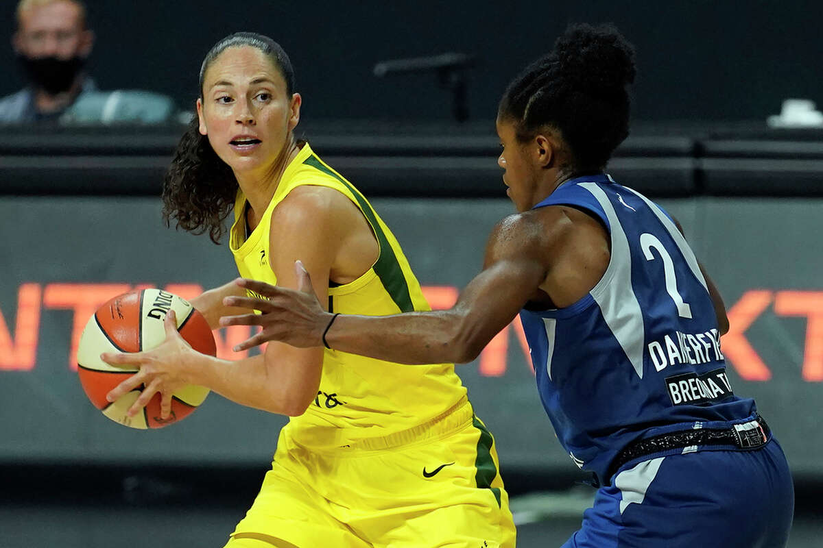 UConn grads meet during the WNBA playoffs as Seattle Storm guard Sue Bird (10) looks to pass around Minnesota Lynx guard Crystal Dangerfield (2) during the second half of Game 3 of a WNBA basketball semifinal round playoff series Sunday, Sept. 27, 2020, in Bradenton, Fla.