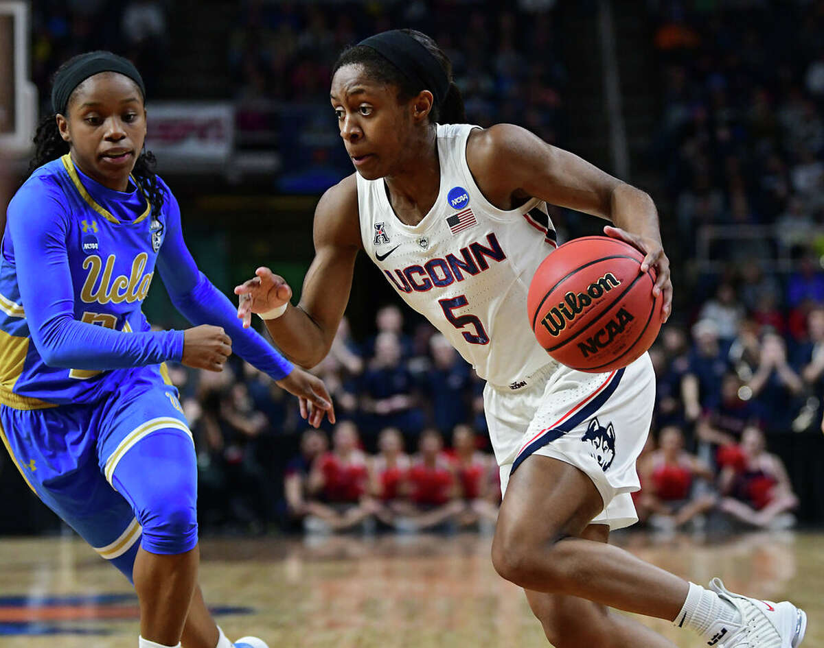 UConn's Crystal Dangerfield drives to the net against UCLA's Japreece Dean in a semifinal for the Albany Regional of the NCAA Women's Basketball Championship at the Times Union Center on Friday, March 29, 2019 in Albany, N.Y. (Lori Van Buren/Times Union)