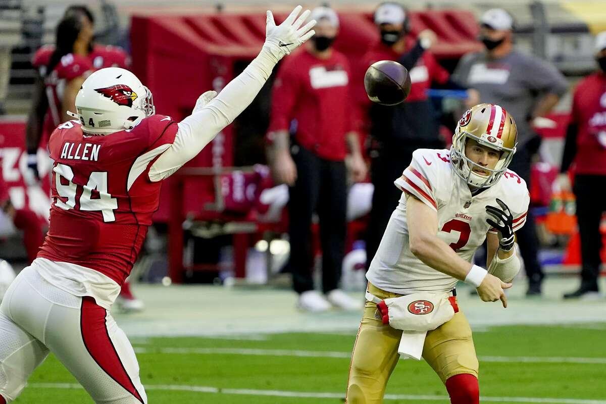 San Francisco 49ers quarterback C.J. Beathard (3) looks to pass as Arizona Cardinals defensive end Zach Allen (94) defends during the first half of an NFL football game, Saturday, Dec. 26, 2020, in Glendale, Ariz. (AP Photo/Rick Scuteri)