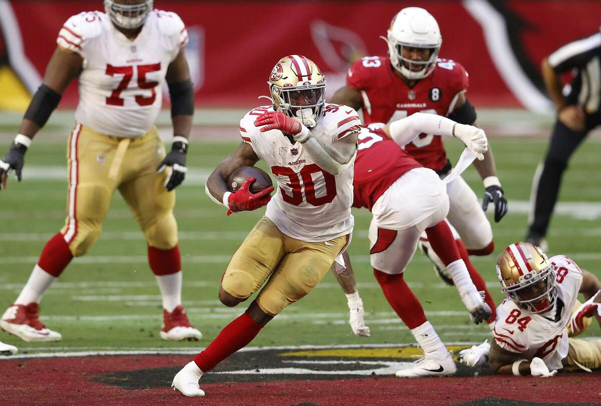 GLENDALE, ARIZONA - DECEMBER 26: Running back Jeff Wilson Jr. #30 of the San Francisco 49ers rushes the football during the first half against the Arizona Cardinals at State Farm Stadium on December 26, 2020 in Glendale, Arizona. (Photo by Christian Petersen/Getty Images)