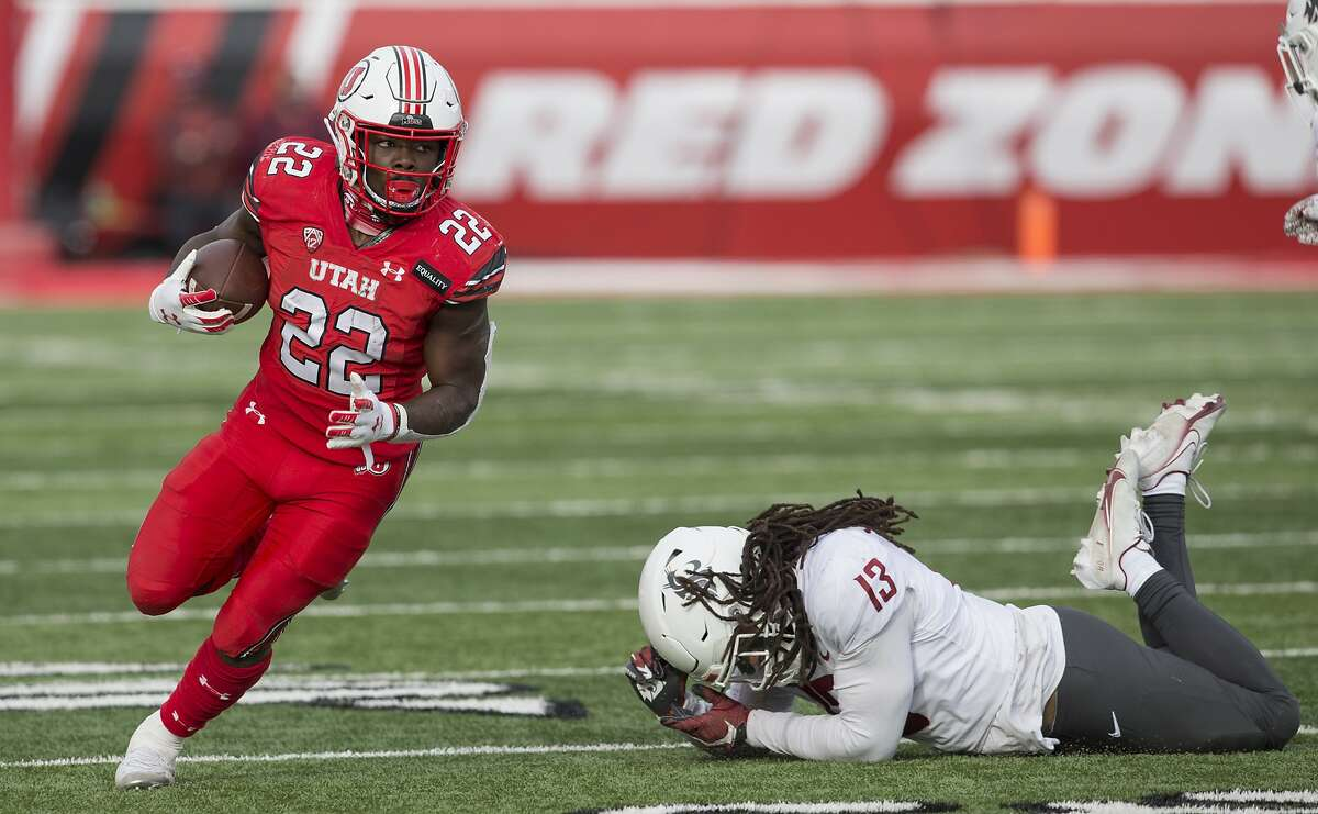 Utah running back Ty Jordan (left), who was the Pac-12 freshman of the year, has died, according to the school. Details about his death were not immediately shared by authorities.