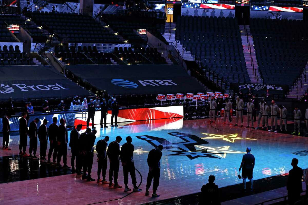 Spurs v Raptors stand for the colors before an empty arena. at AT&T Center on Saturday, Dec. 26, 2020.
