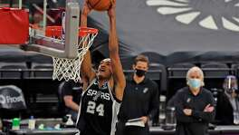 San Antonio Spurs guard Devin Vassell (24) dunks against the Raptors. Spurs v Raptors at AT&T Center on Saturday, Dec. 26, 2020.