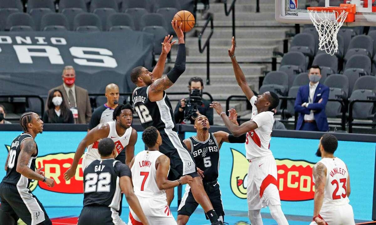 San Antonio Spurs forward LaMarcus Aldridge (12) puts the Spurs ahead for good late in fourth quarter. Spurs v Raptors at AT&T Center on Saturday, Dec. 26, 2020.