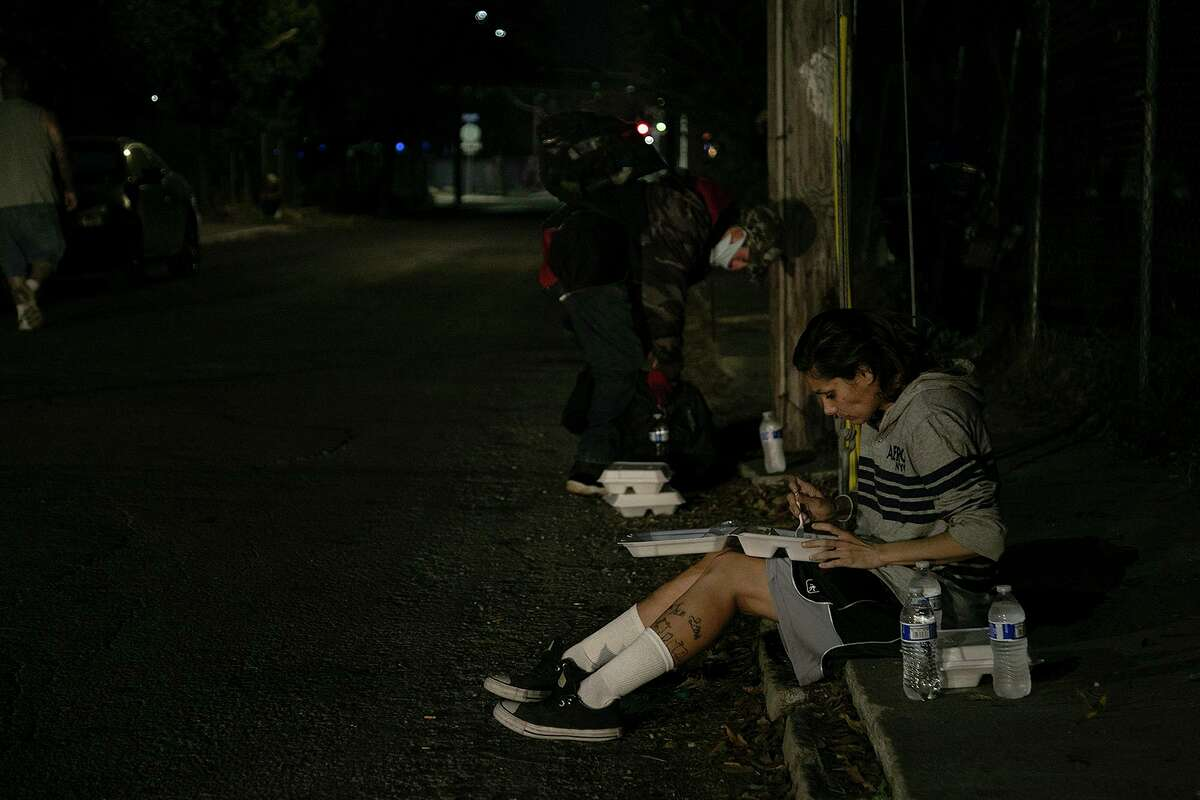 Shavana Nahe eats dinner provided by Church Under the Bridge on Dec. 23, 2020.