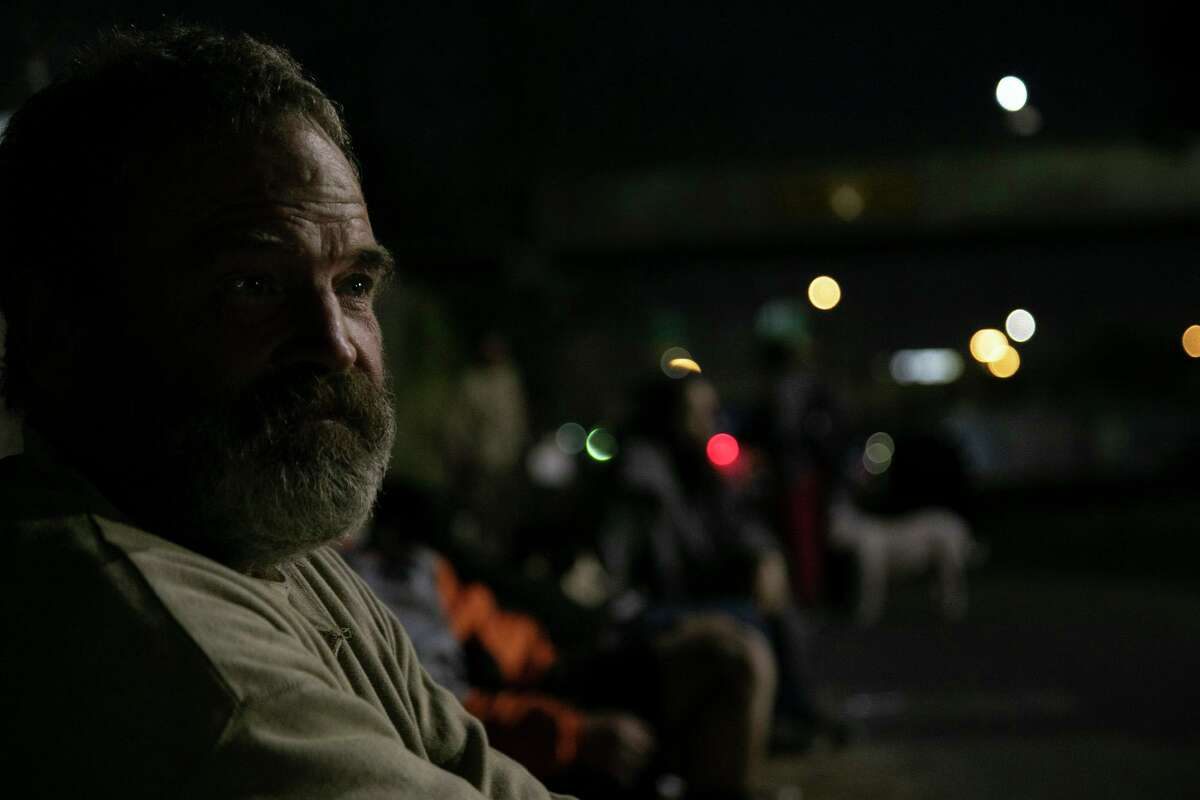 Eddie Wilke waits for seconds after eating dinner provided by Church Under the Bridge on Dec. 23, 2020.
