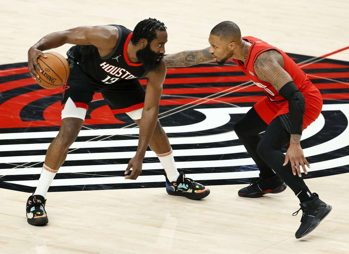 James Harden #13 of the Houston Rockets dribbles against Damian Lillard #0 of the Portland Trail Blazers during the second quarter at Moda Center on December 26, 2020 in Portland, Oregon. (Photo by Steph Chambers/Getty Images)