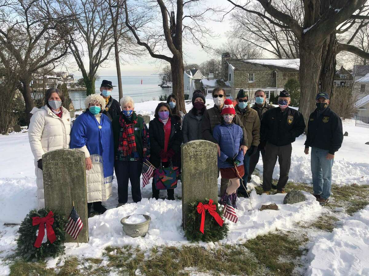 Greenwich in a national tradition by laying wreaths on the graves of two Revolutionary War soldiers buried in the Old Burying Ground. From left, Karen Shapiro, Jolene Mullen, David Wold, Wynn McDaniel, Grace Popp, Karen Popp, Alex Popp, Darcy Popp, Ken Popp, Don Sylvester, Dean Gamanos and First Selectman, Fred Camillo took part.