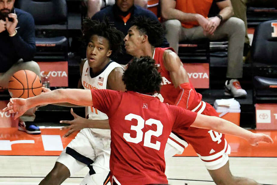 Illinois guard Ayo Dosunmu (11) drives past Indiana's guard Trey Galloway (32) in the second half of an NCAA college basketball game Saturday, Dec. 26, 2020, in Champaign, Ill.