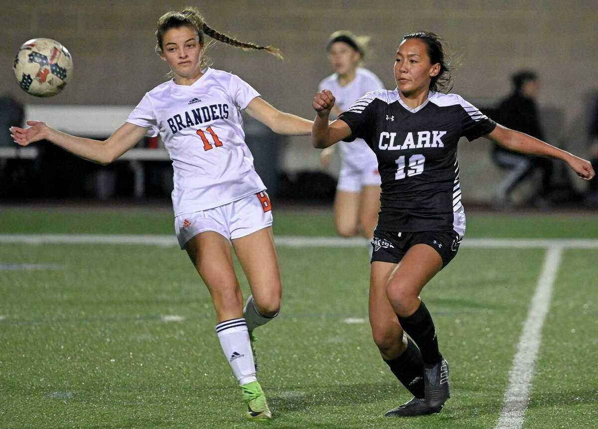 Clark's Hannah Faustino, right, and Brandeis' Margaret Wirebaugh chase the ball during the second half of a girls high school soccer game, Tuesday, Jan. 22, in San Antonio. Clark won 2-1. (Darren Abate/Contributor)