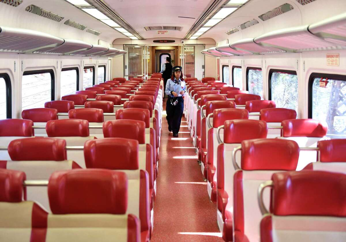 A Metro-North conductor paces the aisles of an empty train car on the route between Greenwich and Stamford on Tuesday, March 24, 2020. Since the coronavirus outbreak, Metro-North has seen a sharp decrease in train commuters.