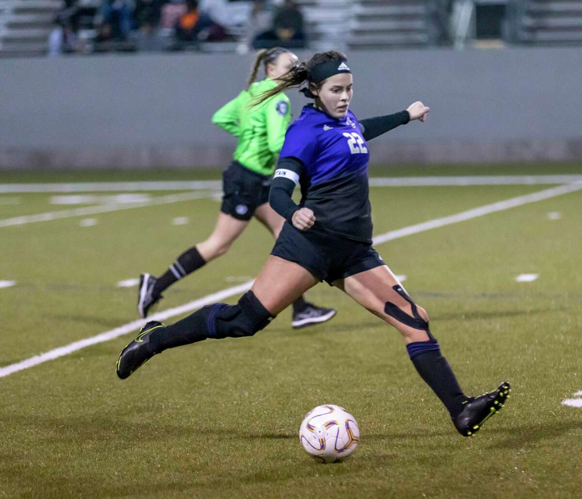 Montgomery midfielder Zoey Prelli (22) kicks thee ball with power in a District 20-5A match against Huntsville high school in Montgomery, Friday, Jan. 31, 2020.