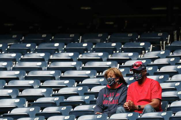 Houston Texans fans watch warm ups before an NFL football game at NRG Stadium on Sunday, Dec. 27, 2020, in Houston. Photo: Brett Coomer, Staff Photographer / © 2020 Houston Chronicle