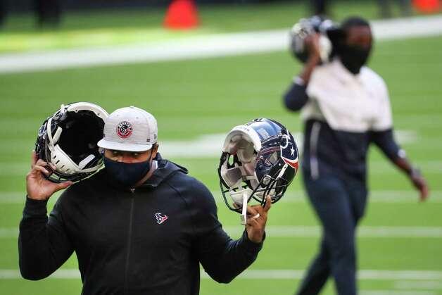 Houston Texans equipment personnel test helmet receivers before an NFL football game at NRG Stadium on Sunday, Dec. 27, 2020, in Houston. Photo: Brett Coomer, Staff Photographer / © 2020 Houston Chronicle