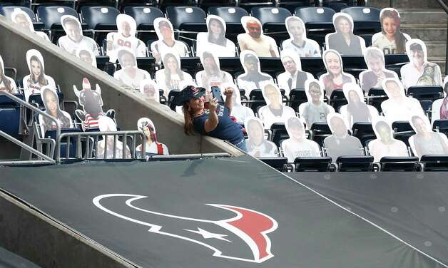 Debby the Texan takes a selfie with cardboard cutouts in the stands before the start of an NFL football game at NGR Stadium, Sunday, December 27, 2020, in Houston. Photo: Karen Warren, Staff Photographer / © 2020 Houston Chronicle