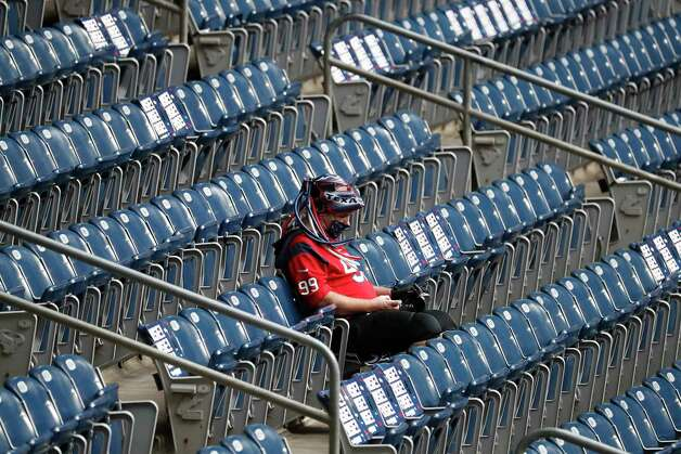 A Houston Texans fan sits alone in the seats before the start of an NFL football game at NGR Stadium, Sunday, December 27, 2020, in Houston. Photo: Karen Warren, Staff Photographer / © 2020 Houston Chronicle