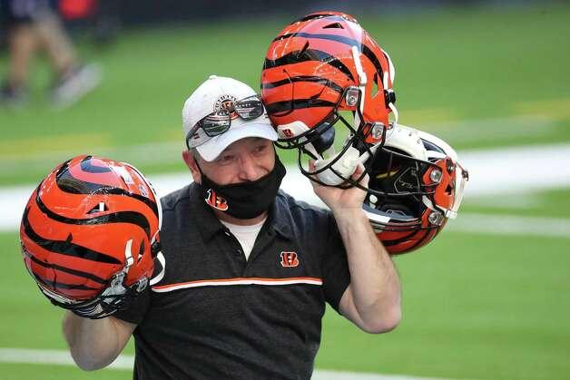 Cincinnati Bengals equipment personnel test helmet receivers before an NFL football game at NRG Stadium on Sunday, Dec. 27, 2020, in Houston. Photo: Brett Coomer, Staff Photographer / © 2020 Houston Chronicle