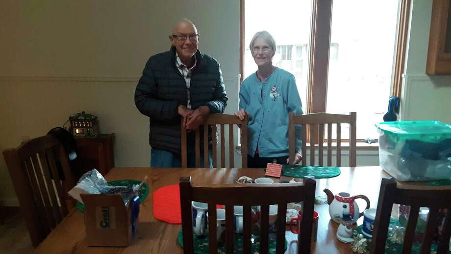 Bob and Sharon Weaver stand behind some of their Christmas items that were saved by church groups from damage in the flooding in May following the mid-Michigan dam failures,on Dec. 23 at their residence at Village West Condominiums in Midland. After about four months of renovations, the Weaverswill soon be able to move back into their residence. (Dan Chalk/chalk@mdn.net)