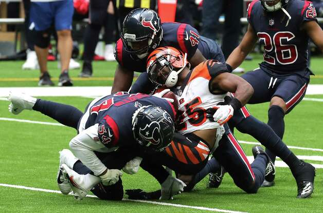Cincinnati Bengals running back Giovani Bernard (25) is stopped by Houston Texans linebackers Jake Martin (54) and  Zach Cunningham (41) during the second quarter of an NFL football game at NRG Stadium on Sunday, Dec. 27, 2020, in Houston. Photo: Brett Coomer, Staff Photographer / © 2020 Houston Chronicle