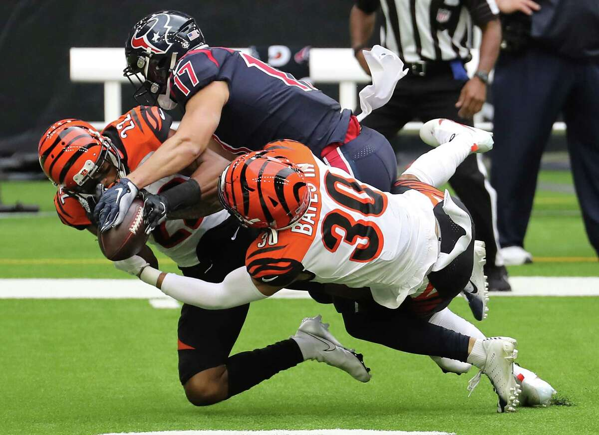 Cincinnati Bengals free safety Jessie Bates (30) and cornerback William Jackson (22) break up a pass intended for Houston Texans wide receiver Chad Hansen (17) during the second quarter of an NFL football game at NRG Stadium on Sunday, Dec. 27, 2020, in Houston.