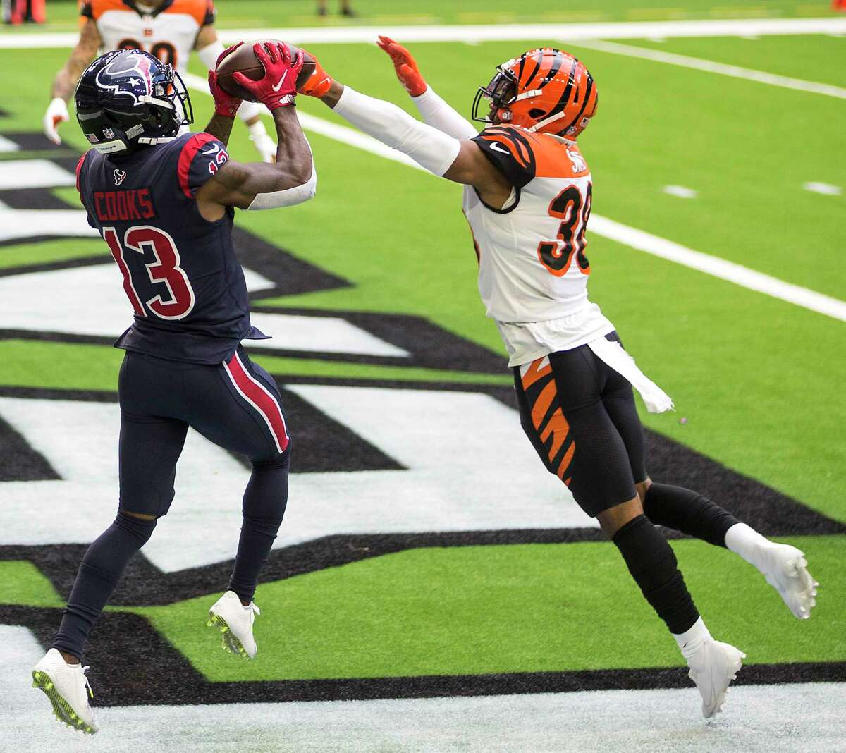 Houston Texans wide receiver Brandin Cooks (13) beats Cincinnati Bengals free safety Jessie Bates (30) into the end zone for a touchdown reception during the second quarter of an NFL football game at NRG Stadium on Sunday, Dec. 27, 2020, in Houston.