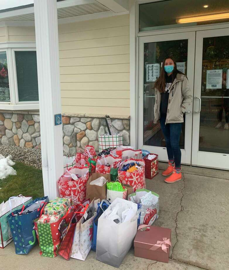 Ellen Bretzke, a senior member of Benzie Central's varsity girls basketball team, helps drop off the presents her team helped collect at Frankfort Pines Assisted Living. (Submitted photo)