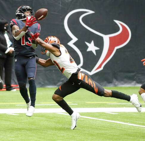 Houston Texans wide receiver Brandin Cooks (13) catches a long pass from quarterback Deshaun Watson as Cincinnati Bengals cornerback William Jackson (22) defended on the play during the first quarter of an NFL football game at NGR Stadium, Sunday, December 27, 2020, in Houston. Photo: Karen Warren, Staff Photographer / © 2020 Houston Chronicle