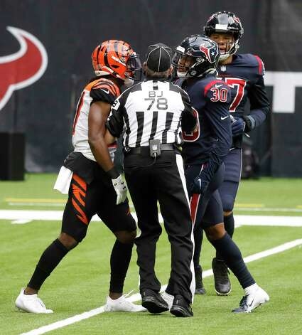 Back Judge Greg Meyer breaks up an exchange between Cincinnati Bengals defensive back Tony Brown (27) and Houston Texans cornerback Cornell Armstrong (30) during the first quarter of an NFL football game at NGR Stadium, Sunday, December 27, 2020, in Houston. Photo: Karen Warren, Staff Photographer / © 2020 Houston Chronicle