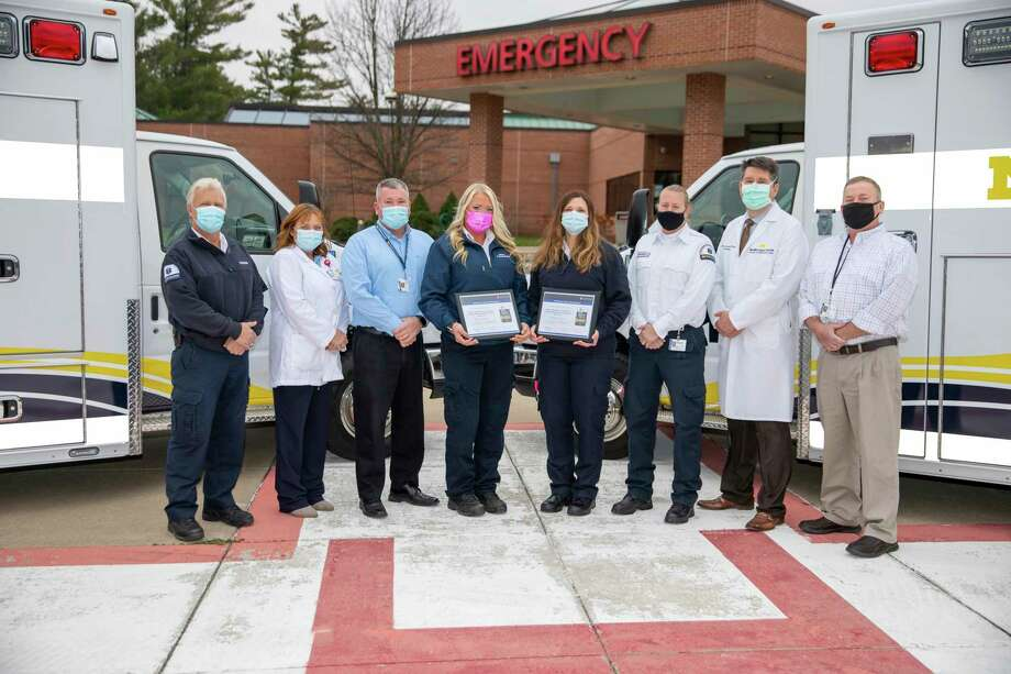 Members of MidMichigan's Regional STEMI Program are (from left) Paramedic Jay Moore, EMT-P, MidMichigan Medical Center - EMS, Gladwin; Deanna Knopp, R.N., B.S.N., system director of MidMichigan's Emergency Services; John Clayton, manager of MidMichigan Medical Center - EMS, Gladwin; Paramedic Mary Datte, EMT-P, MidMichigan Medical Center - EMS, Gladwin; Paramedic Jamie Campbell, EMT-P, MidMichigan Medical Center - EMS, Midland; Paramedic Stacey Rohn, EMT-P, MidMichigan Medical Center - EMS, Midland; Michael Lauer, M.D., interventional cardiologist and director of MidMichigan's Regional STEMI Program; and Scott Shawl, manager of MidMichigan Medical Center - EMS, Midland. (Photo Provided)