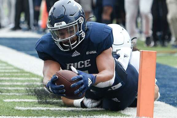 Tight end Jordan Myers, scoring against UAB last season, is one of five Rice senior taking advantage of the NCAA's eligiblity rules to return for another year.