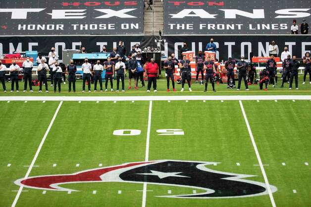 Houston Texans players and coaches line up, with some taking a knee, for the national anthem before sn NFL football game against the Cincinnati Bengals at NRG Stadium on Sunday, Dec. 27, 2020, in Houston. Photo: Brett Coomer, Staff Photographer / © 2020 Houston Chronicle