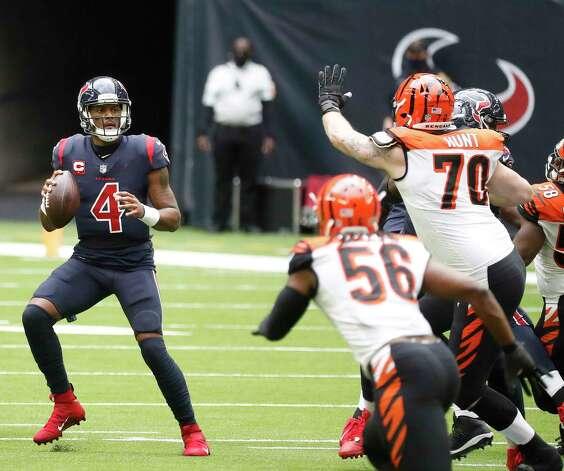 Houston Texans quarterback Deshaun Watson (4) looks to pass the ball during the second quarter of an NFL football game at NGR Stadium, Sunday, December 27, 2020, in Houston. Photo: Karen Warren, Staff Photographer / © 2020 Houston Chronicle