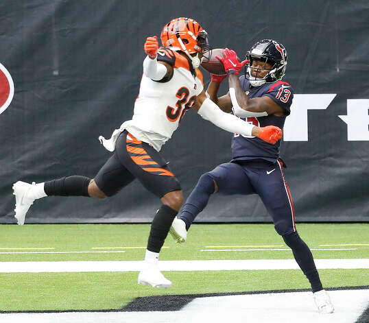 Houston Texans wide receiver Brandin Cooks (13) catches the ball in the end zone for the touchdown against Cincinnati Bengals cornerback LeShaun Sims (38) during the second quarter of an NFL football game at NGR Stadium, Sunday, December 27, 2020, in Houston. Photo: Karen Warren, Staff Photographer / © 2020 Houston Chronicle