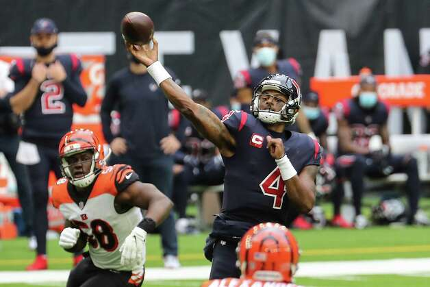 Houston Texans quarterback Deshaun Watson (4) throws a pass to wide receiver Brandin Cooks for a 25-yard touchdown against the Cincinnati Bengals during the second quarter of an NFL football game at NRG Stadium on Sunday, Dec. 27, 2020, in Houston. Photo: Brett Coomer, Staff Photographer / © 2020 Houston Chronicle