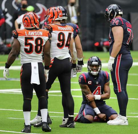 Houston Texans quarterback Deshaun Watson (4) holds his arm after he was tackled running out of the pocket against the Cincinnati Bengals during the second quarter of an NFL football game at NRG Stadium on Sunday, Dec. 27, 2020, in Houston. Photo: Brett Coomer, Staff Photographer / © 2020 Houston Chronicle