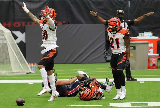 Cincinnati Bengals free safety Jessie Bates (30),  cornerback William Jackson (22) and cornerback Mackensie Alexander (21) celebrate after breaking up a pass intended for Houston Texans wide receiver Chad Hansen (17) during the second quarter of an NFL football game at NRG Stadium on Sunday, Dec. 27, 2020, in Houston. Photo: Brett Coomer, Staff Photographer / © 2020 Houston Chronicle